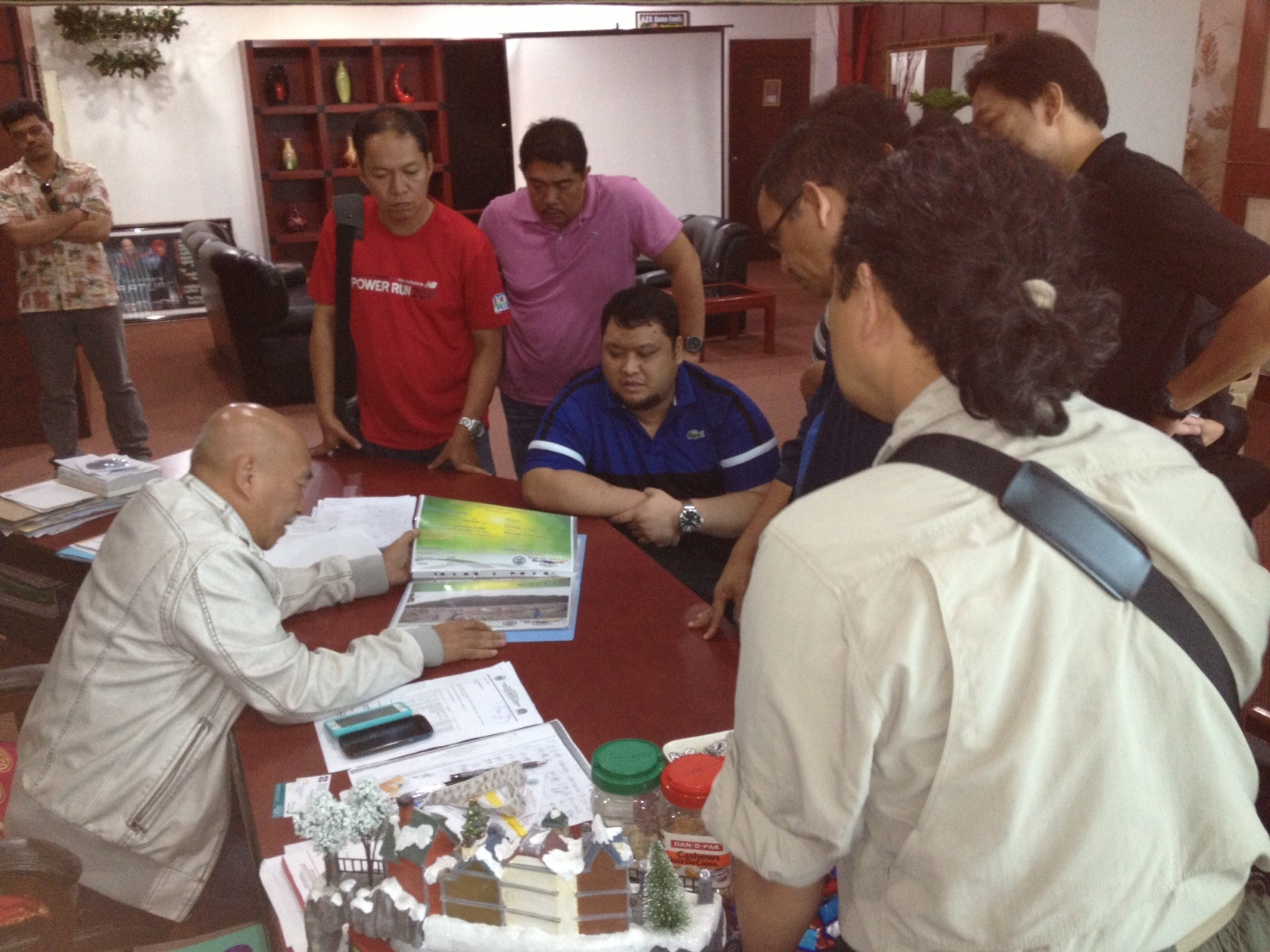 Arturo Uy (left), Provincial Governor of Compostella Valley, shares with us the typhoon devastated areas declared as geo-hazard zones. I was accompanying Assistant Secretary Rolando Cucio, Office of the President – Republic of the Philippines (standing in front of me), as he was making an assessment of the typhoon-devastated areas along with his technical staff. This is part of the consultation process we're doing as we make our operational transition from relief to rehabilitation.